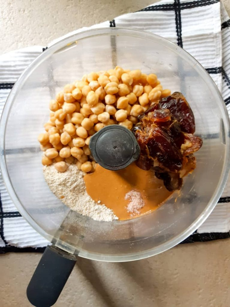 Ingredients needed for chickpea blondies in a food processor